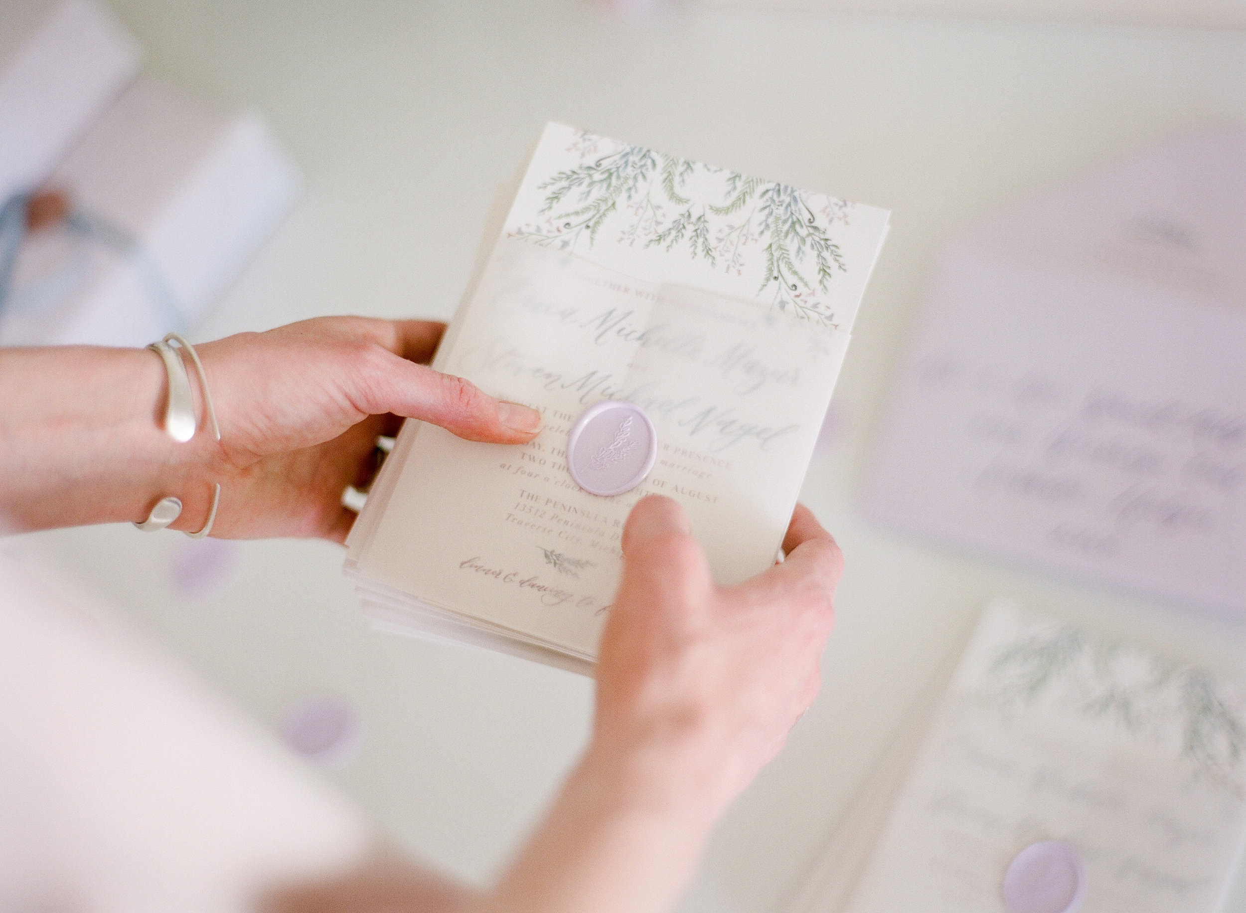 Putting the final details on a suite is one of our favorite parts of the assembly process. This  particular  suite's subtle vellum wrap and custom wax seal quite literally makes us want to jump into a giant pile of lavender. It's just that dreamy.