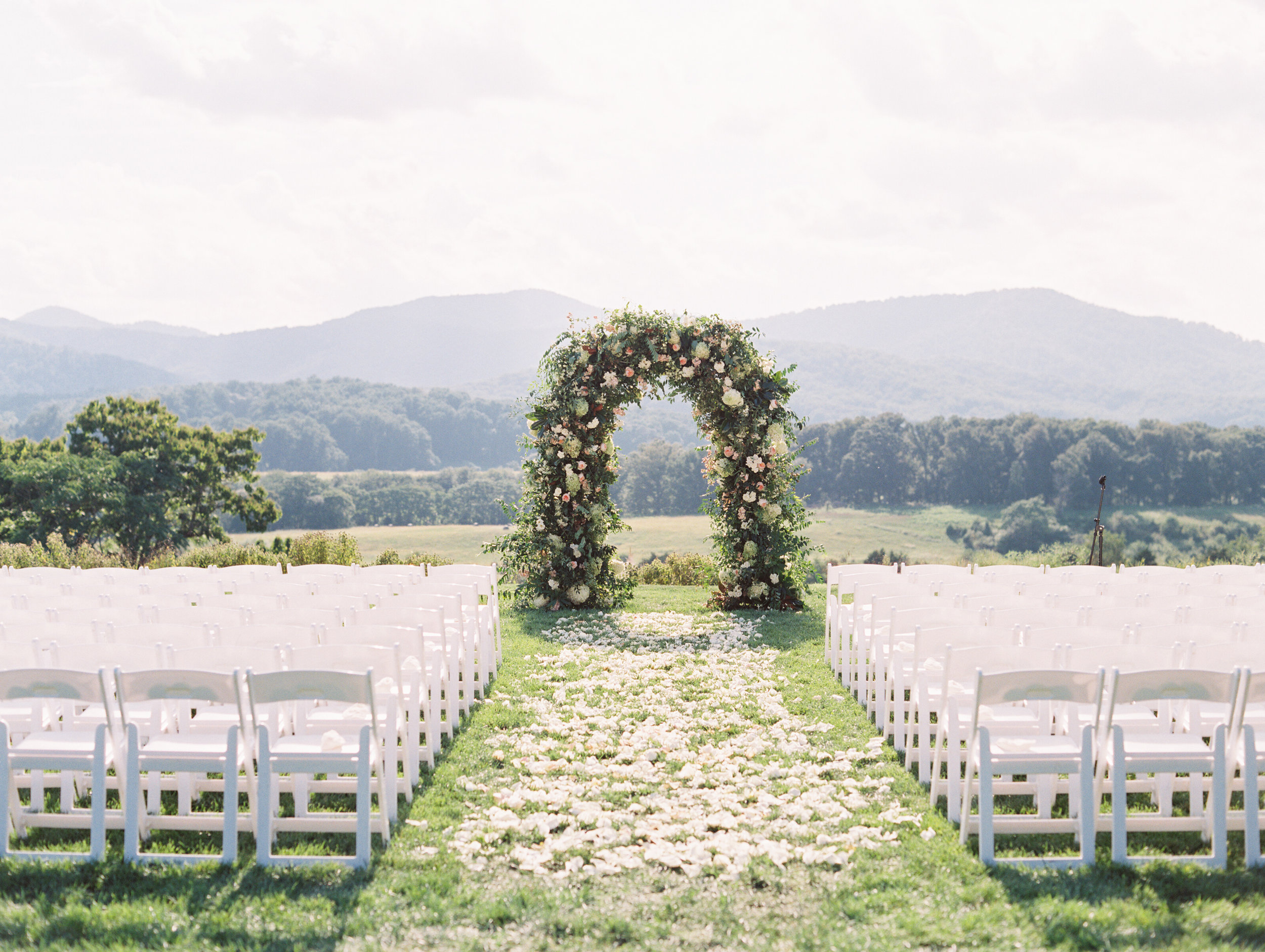 How enchanting is this floral arbor expertly designed by    Southern Blooms   ? Be still our hearts.