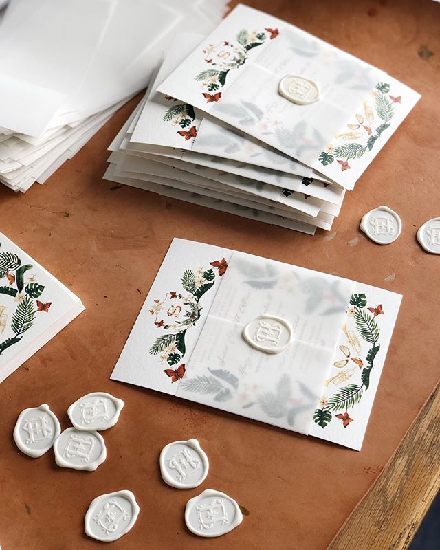 Vellum wraps and wax seals for the perfect finishing touch on these custom New Orleans wedding invitations