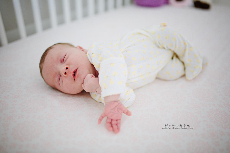 newborn-girl-sleeping-in-crib.jpg