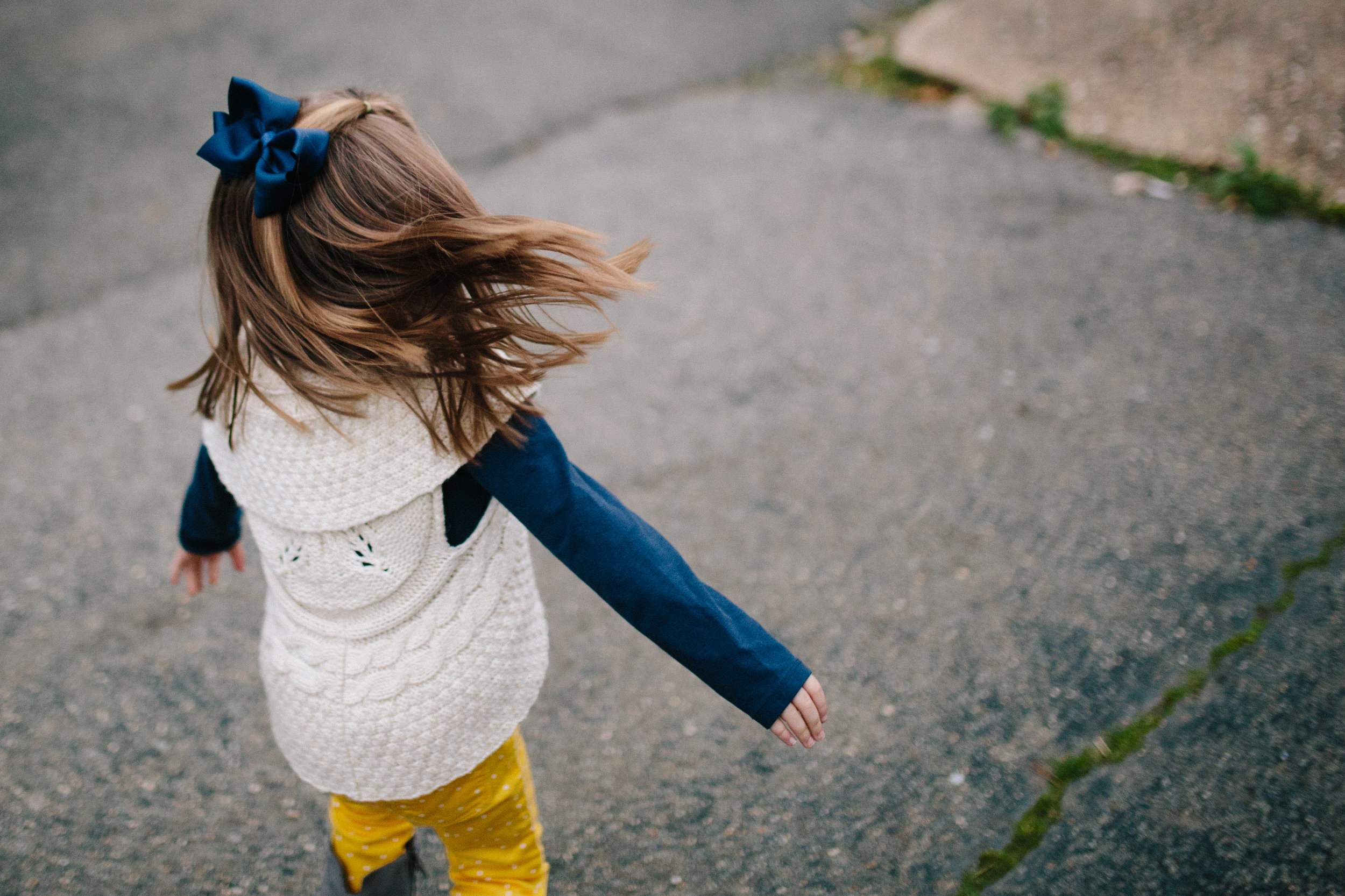 child-walking-with-arms-open