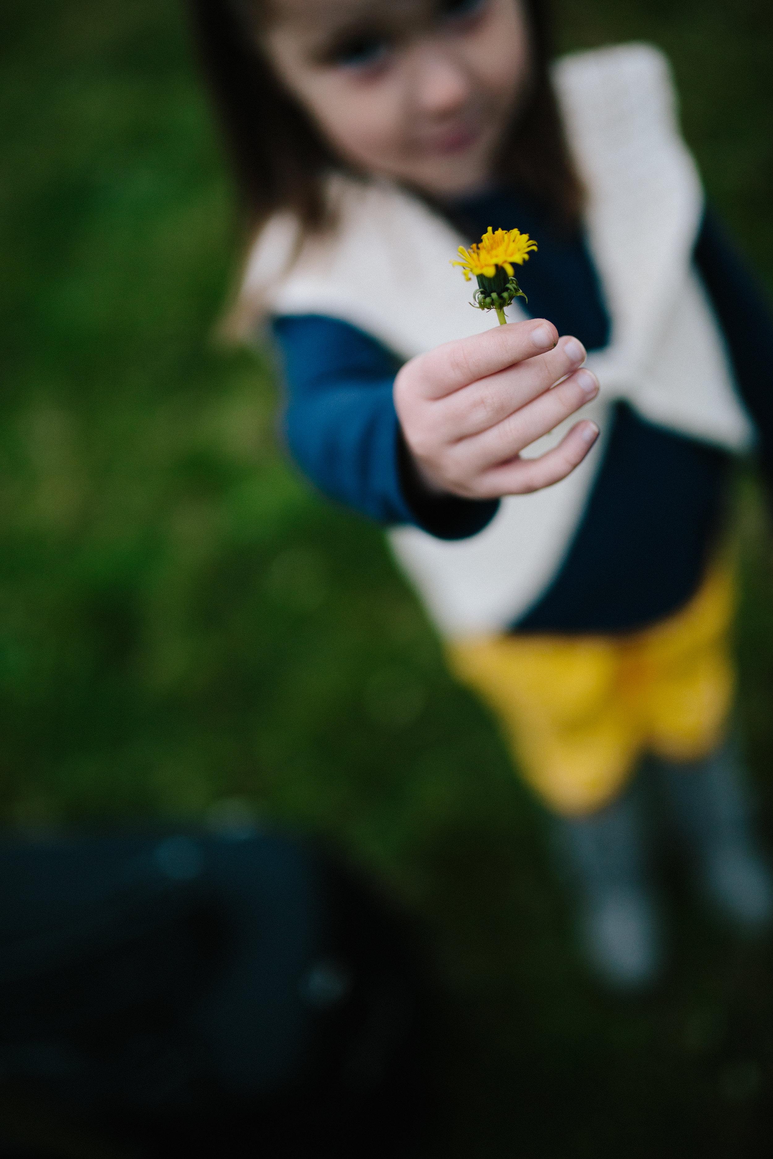 child-holding-flower
