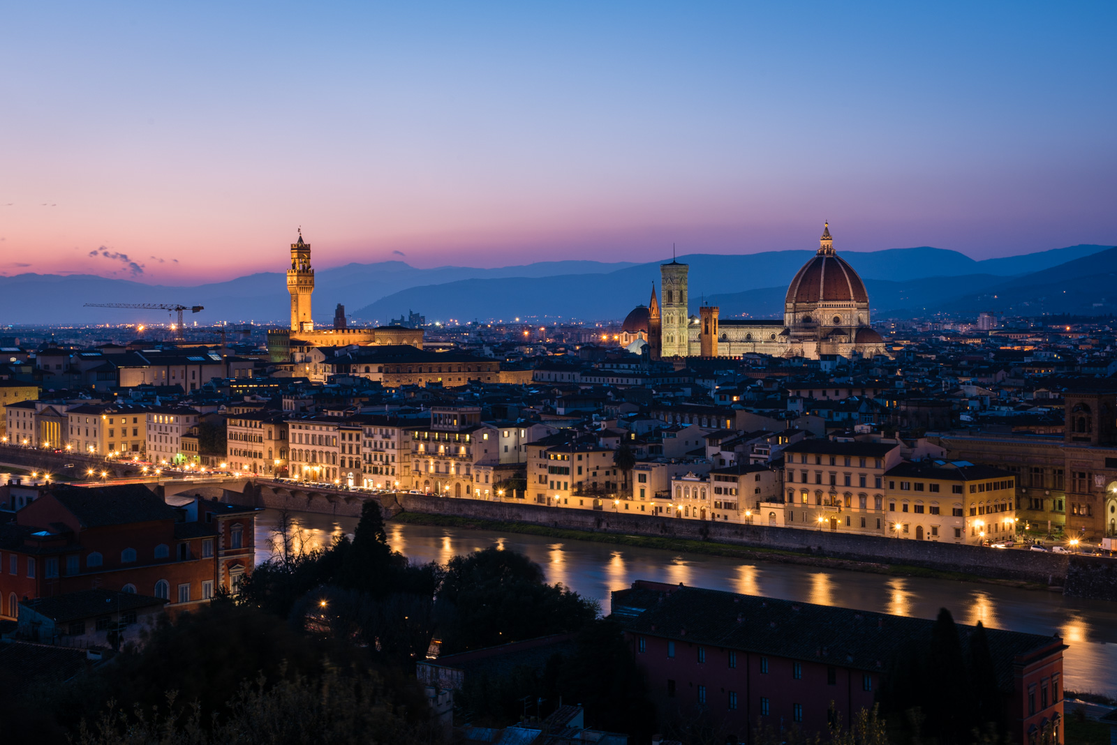 A photo during sunset at Piazzale Michelangelo, overlooking Florence.