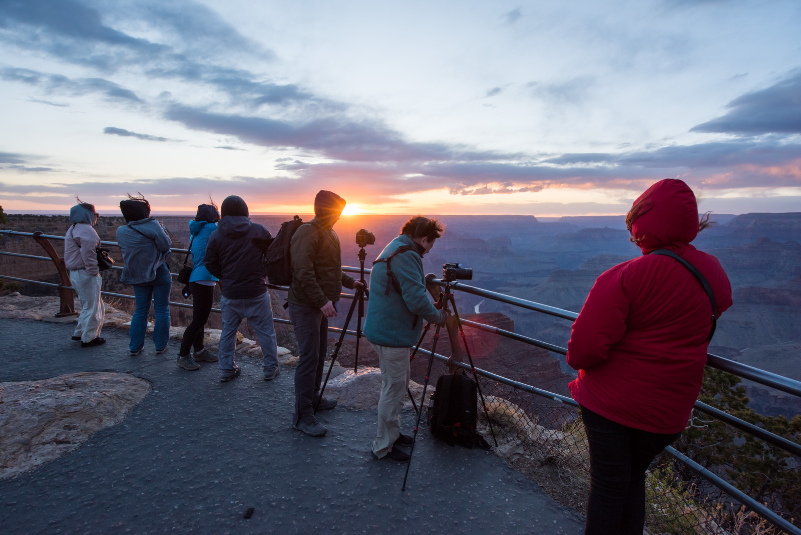 Sun flare & photographers, toughing it out for sunset