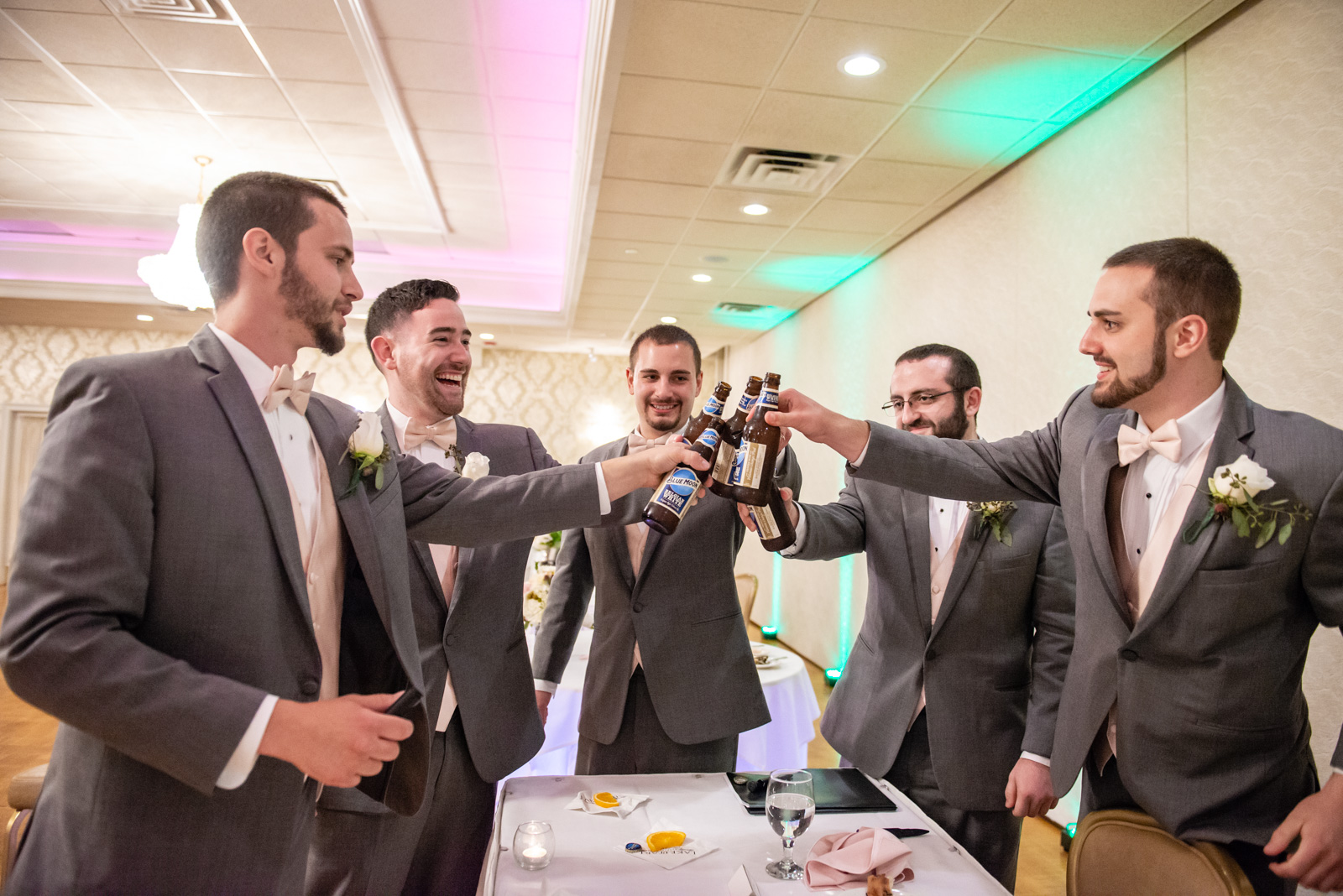 The groomsmen, cracking open some cold ones.