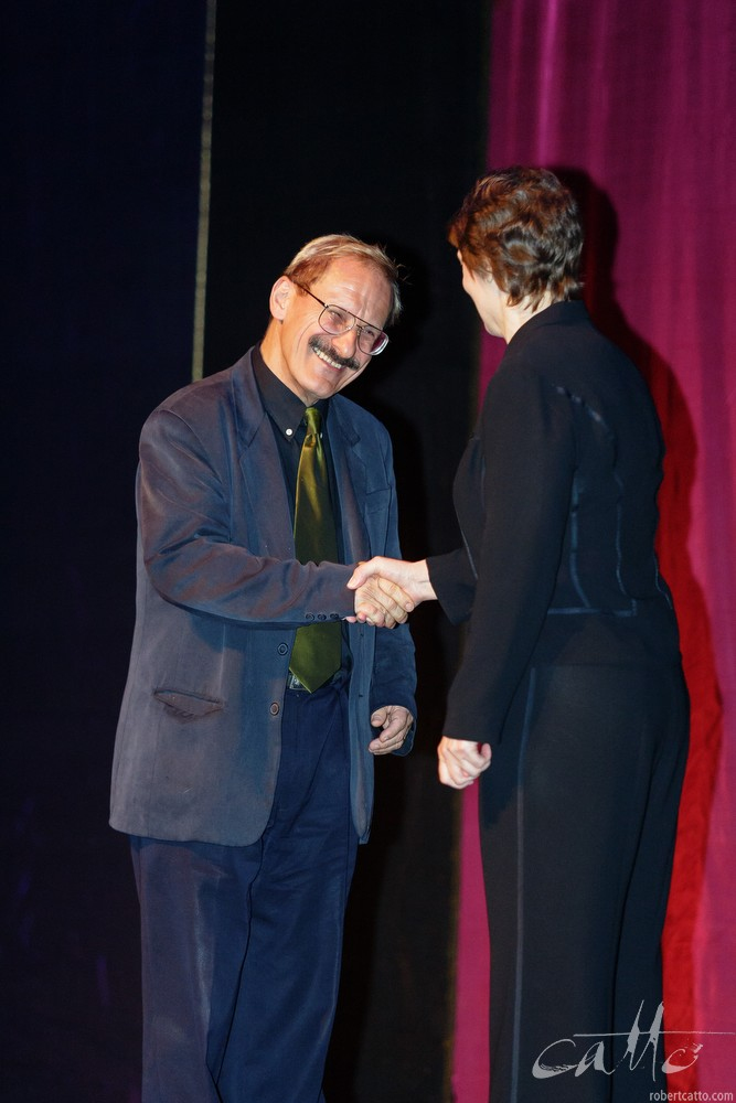 Jack Body receiving the Arts Foundation Laureate Award from Prime Minister Helen Clark, at the St James Theatre in Wellington, 2004.