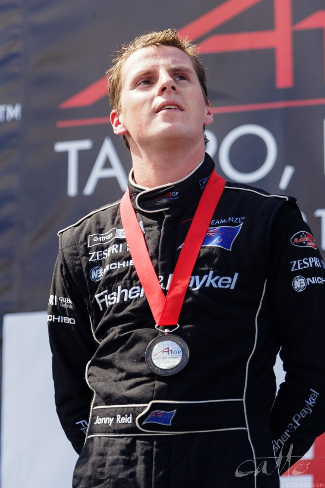 New Zealand driver Jonny Reid on the third step of the podium in Taupo.