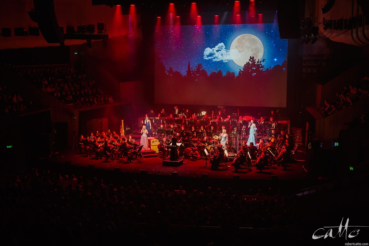 The cast with the Sydney Symphony Orchestra.