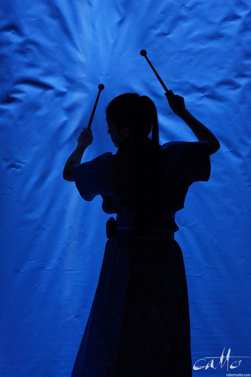 A percussionist plays a hanging sheet of paper in Tan Dun's opera, Tea: A Mirror Of Soul at the New Zealand International Arts Festival 2006 (click the image to embiggen)