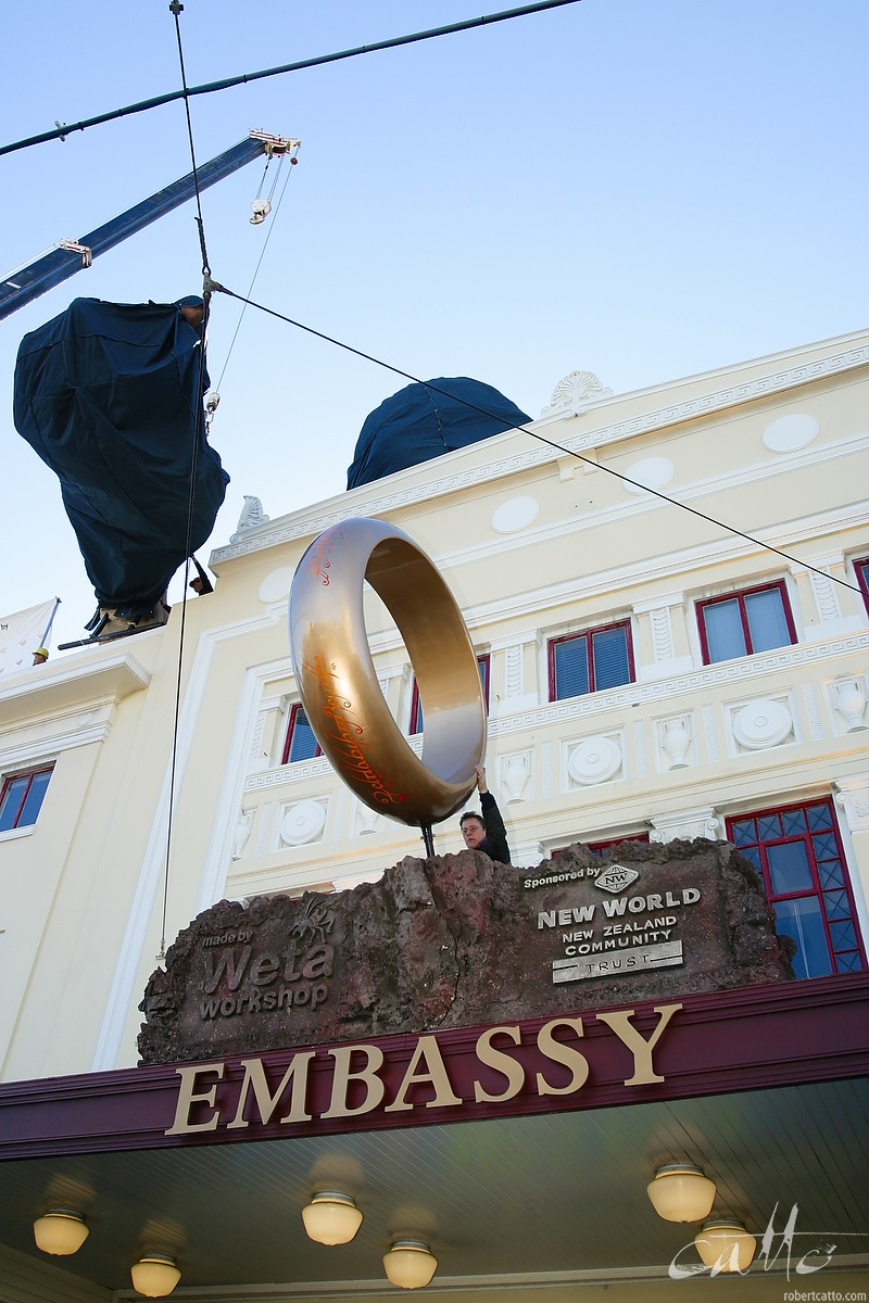 Weta Workshop founder Richard Taylor steadies the ring on the awning of the Embassy Theatre