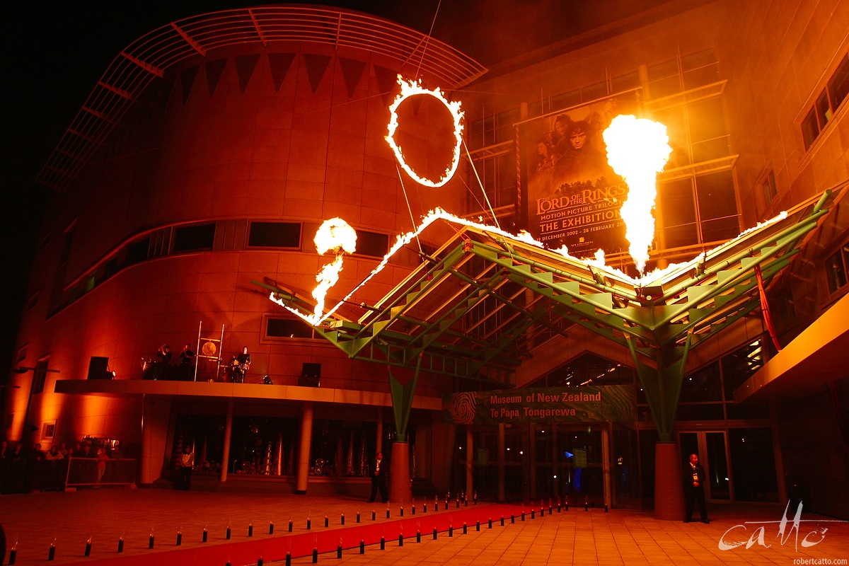 Percussion group Strike perform as flames leap on the front of Te Papa for at the Australasian Premiere of The Lord Of The Rings: The Two Towers.
