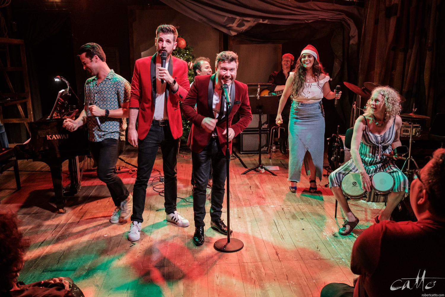 Hosts Toby Francis and Dash Kruck join the cast of In The Heights at the end of Feliz Navidad.