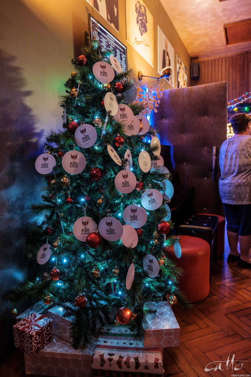 Plates representing donations to the Wayside Chapel from audience members overwhelming the Christmas Tree in the lobby at the Hayes Theatre.