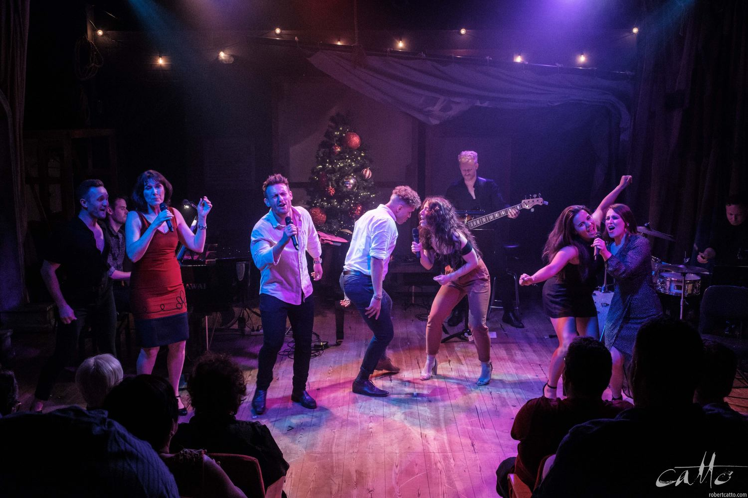 The cast of Cry-Baby storm the stage, and perform Run Run Rudolph.
