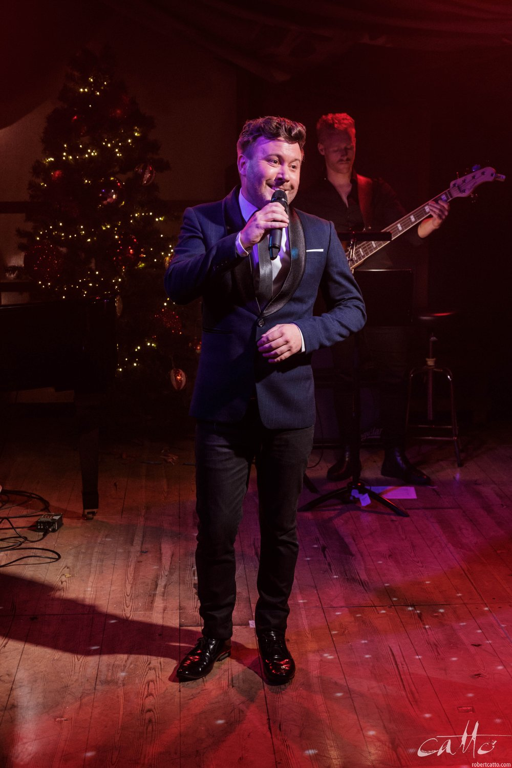 Dash Kruck sings Have Yourself A Merry Little Christmas as the event begins to wind up for another year.