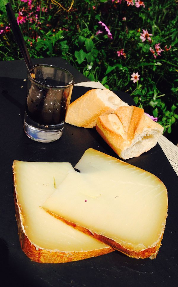 Ossau-Iraty with black cherry jam, a typical condiment with cheese in the  pays basque . Dessert in the sun at the outstanding  Cornelius Restaurant  in  Levallois Perret .