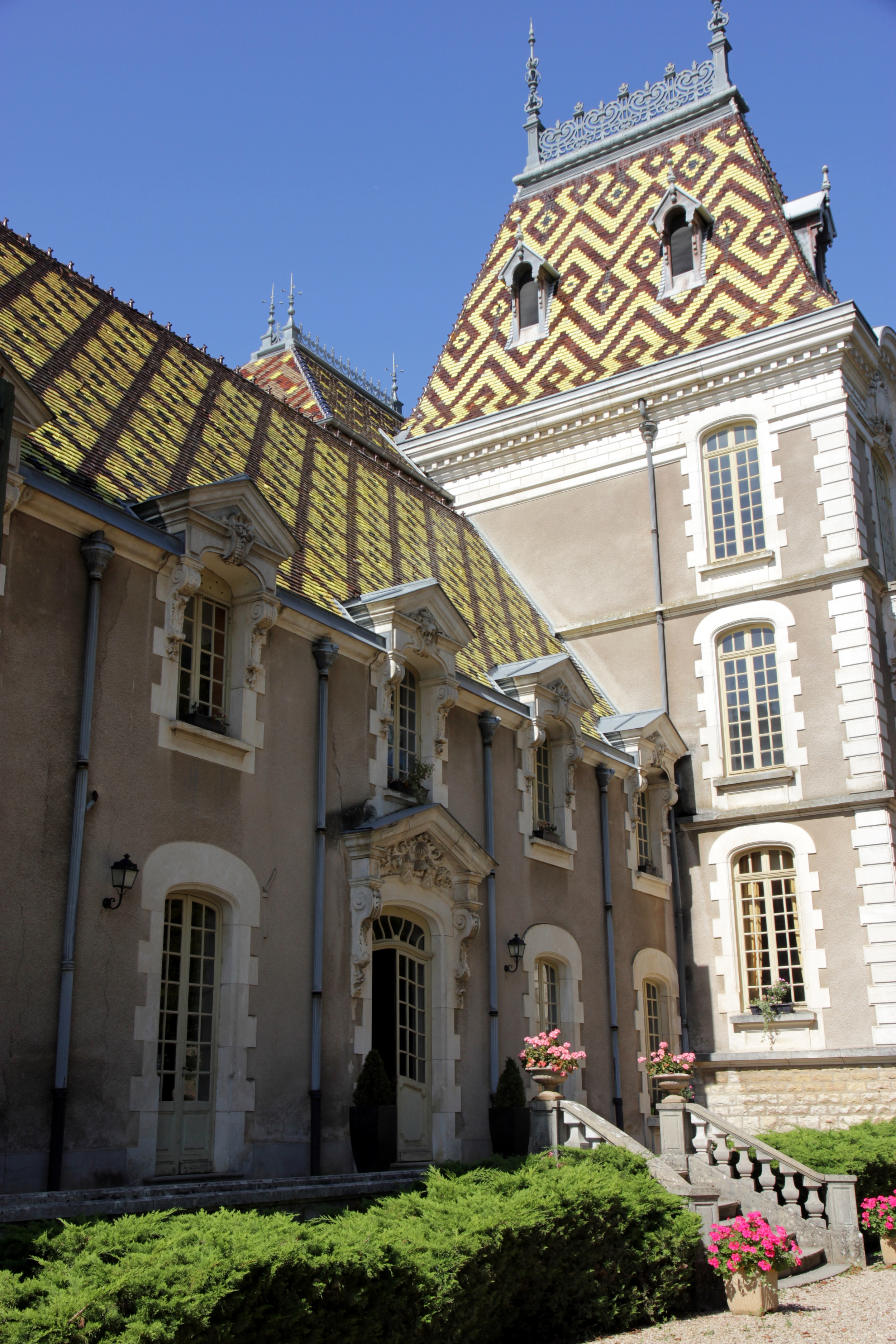 The Château Corton André with its glazed tile roof.