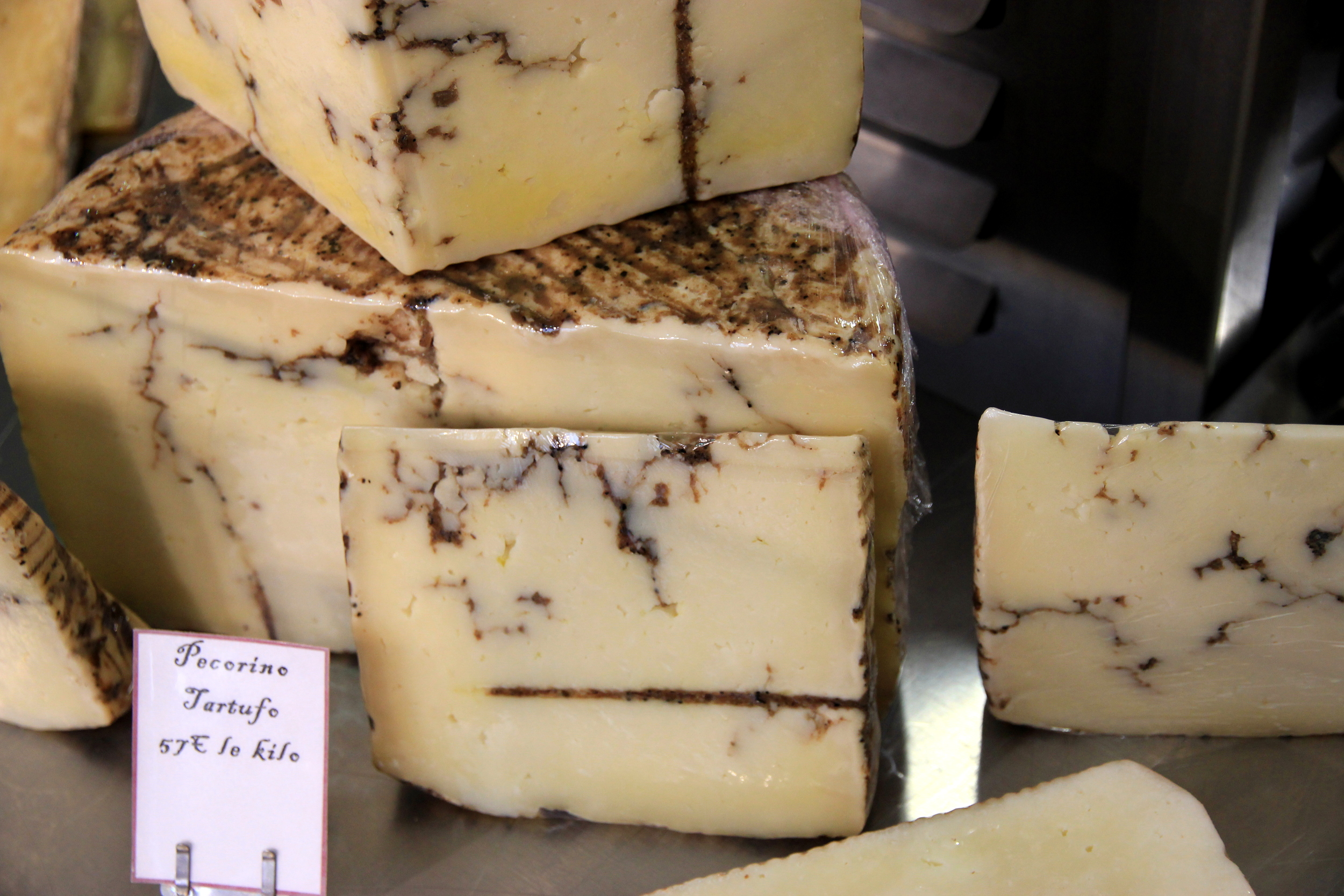 Pecorino cheese with truffles. Completely outrageous. / Fromage italien pecorino avec des truffes. Incroyablement, scandaleusement délicieux.
