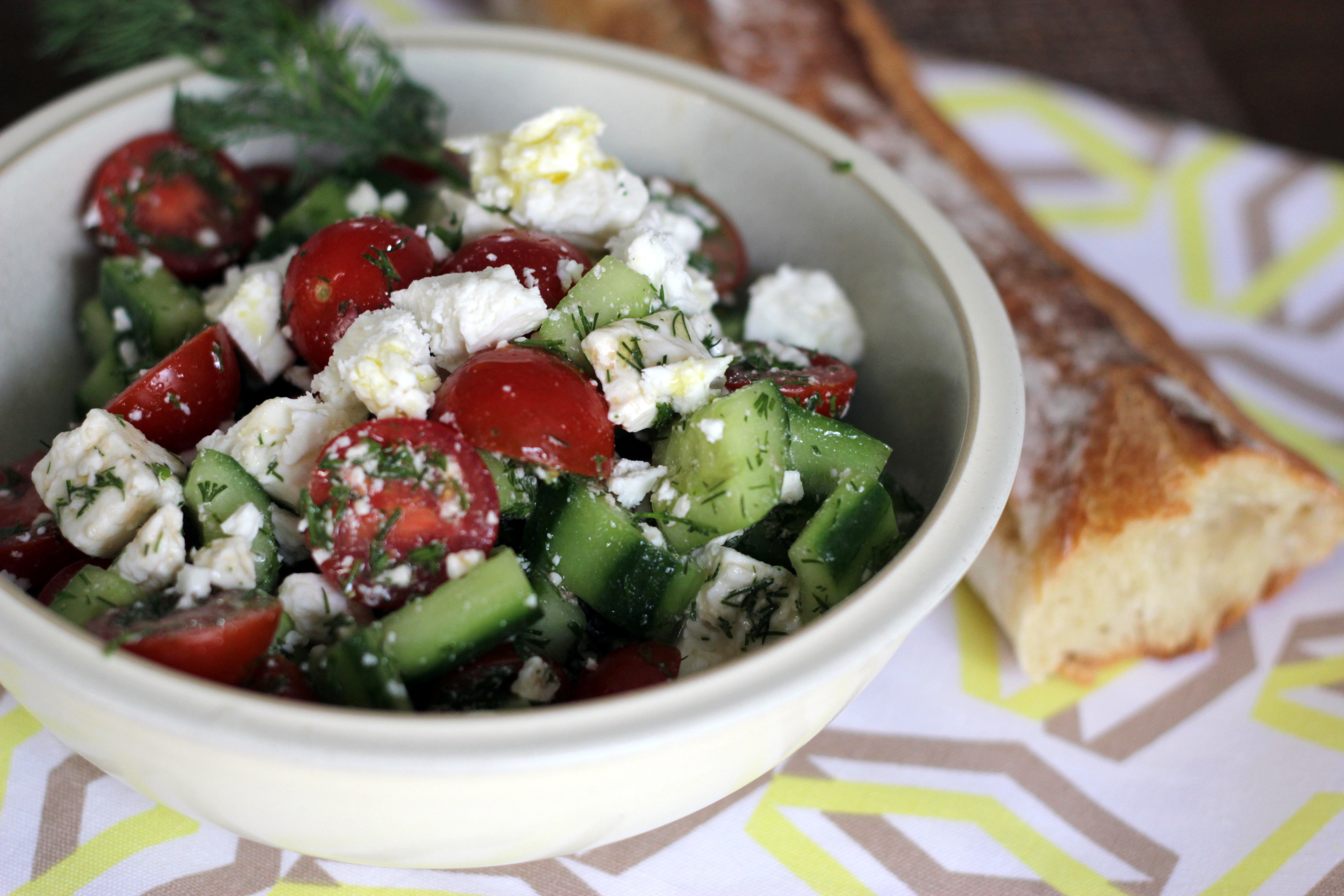 My favorite thing to do with feta: greek salad. This one has fresh cherry tomatoes and mini cucumbers from the market and some really nice red wine vinegar.
