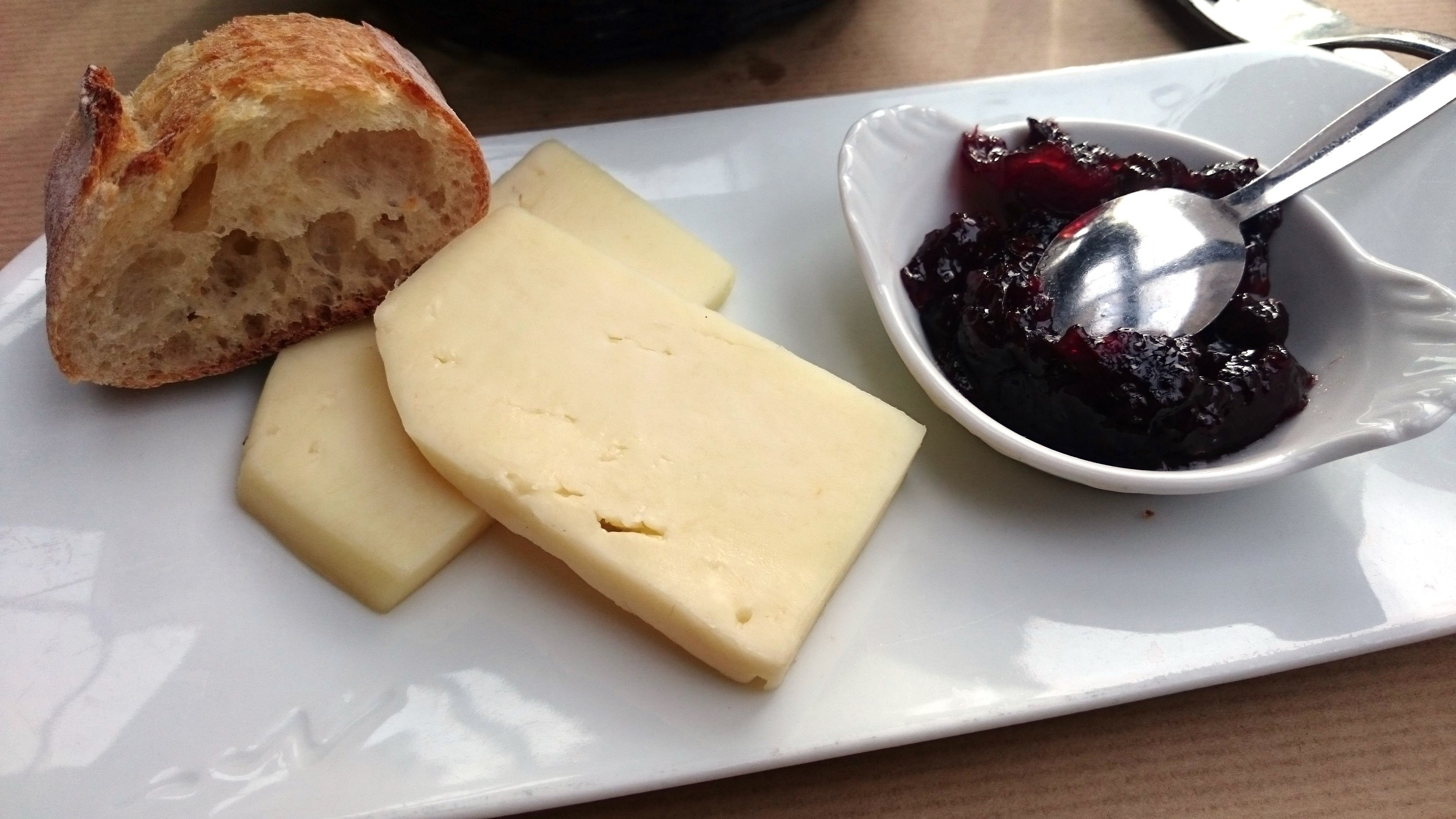 Tomme de brebis , a sheep's cheese from the Southwest of France with the regional condiment of black cherry jam.