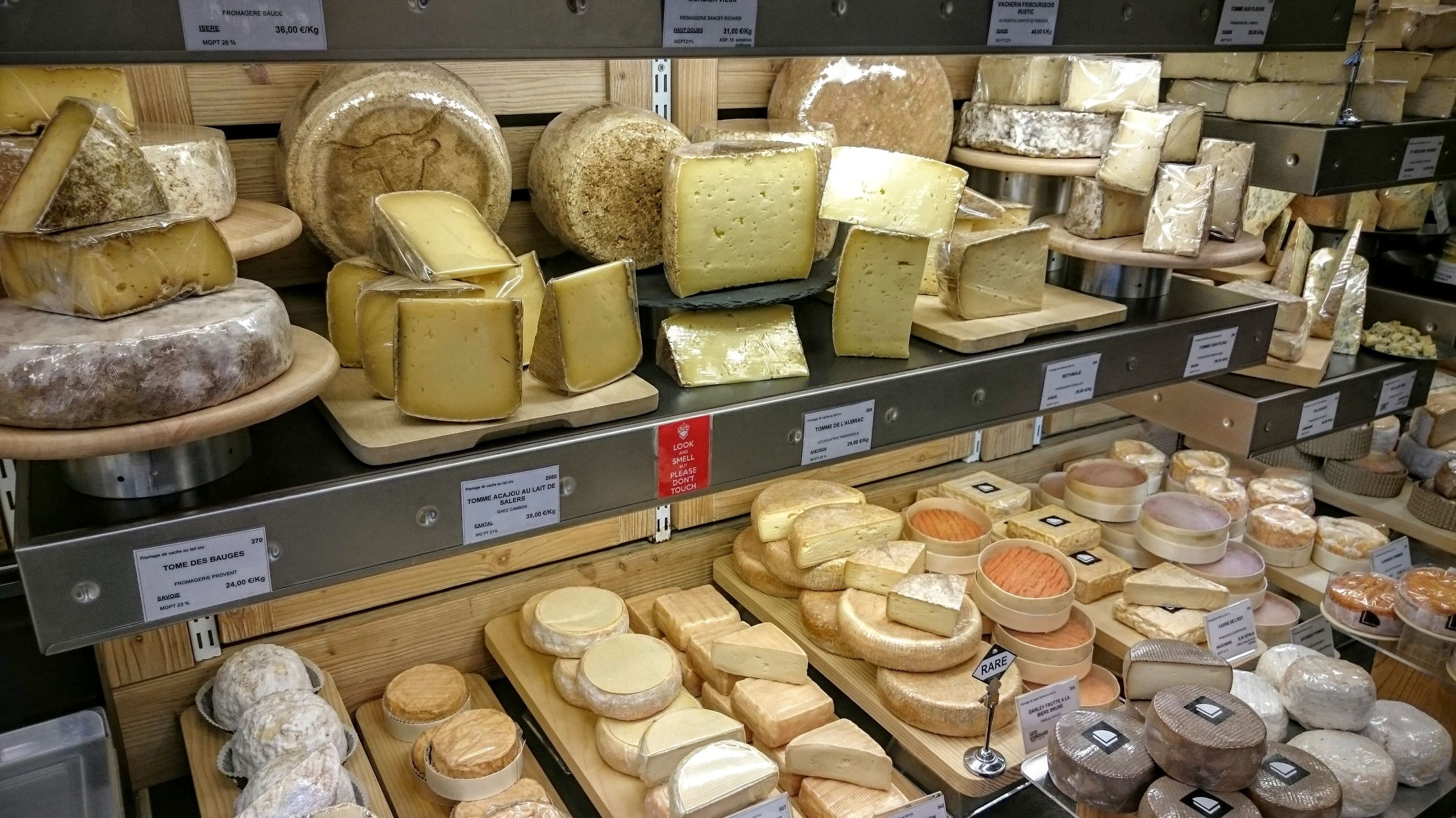 Tommes on top (semi-hard cheeses), mix on the bottom including some from Burgundy (spot the Époisses?)