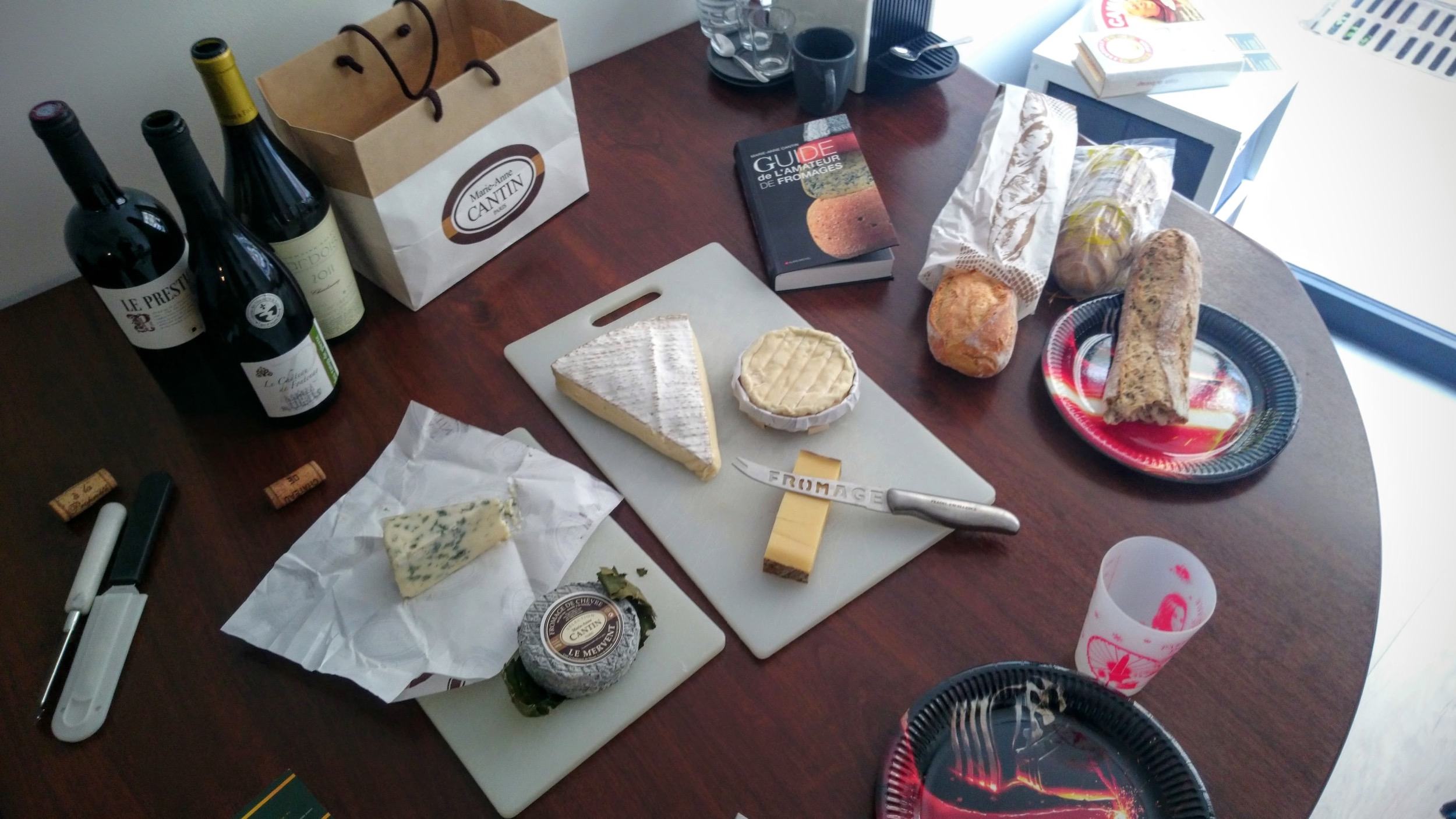 The spread as it looked at my office, with various wine and cheese pairings. The Star Wars plates add to the class! (It's all I had.)