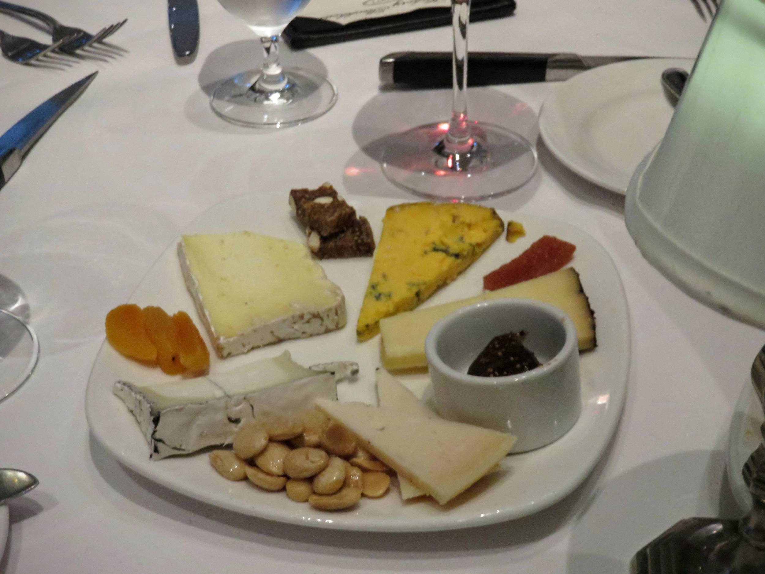 My favorite of the cheeses was the Humboldt Fog, an American-made cheese with a soft white interior, a streak of blue, and a blooming rind. It's on this plate at 8 o'clock.