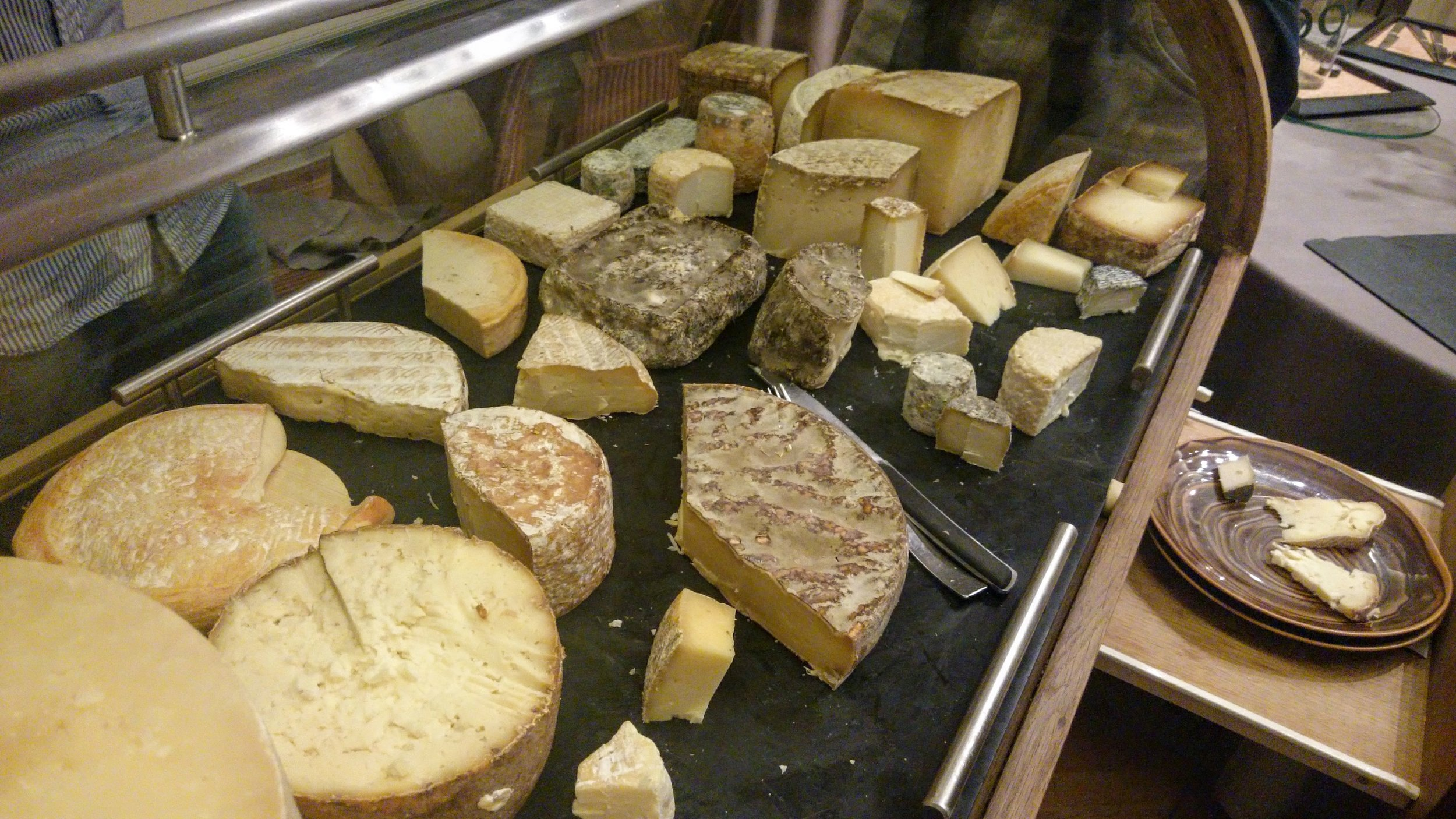 The Cheese Chariot at Château de Champing. These were all Mons cheeses except for the Fourme Blanche (bottom/front/left) and the small palet shape just to its north.