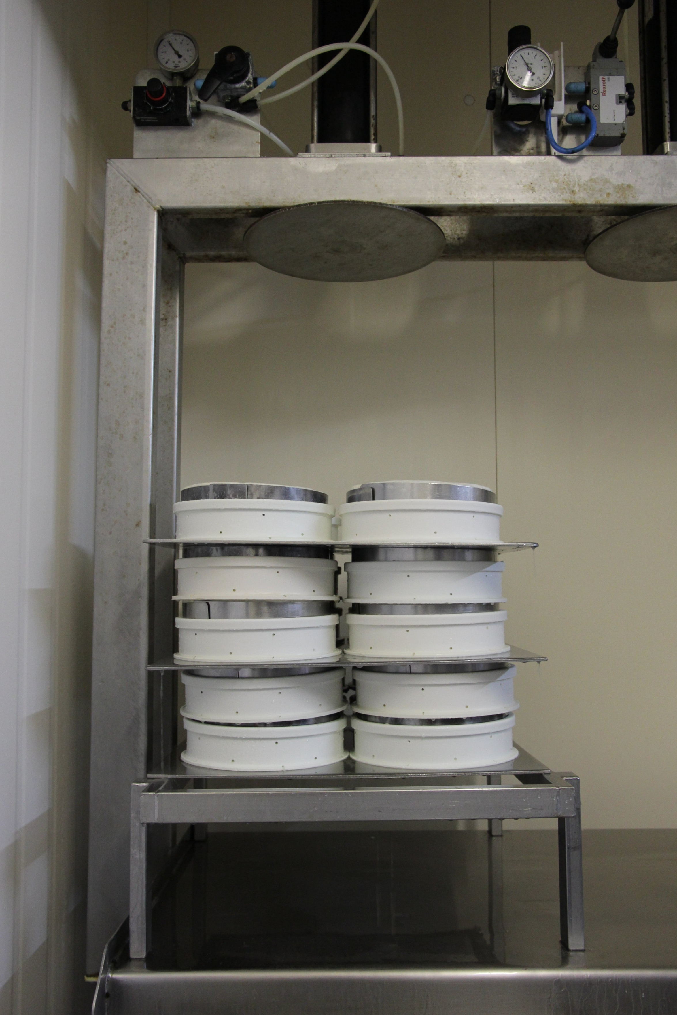 The molds are now stacked for their formal pressing.