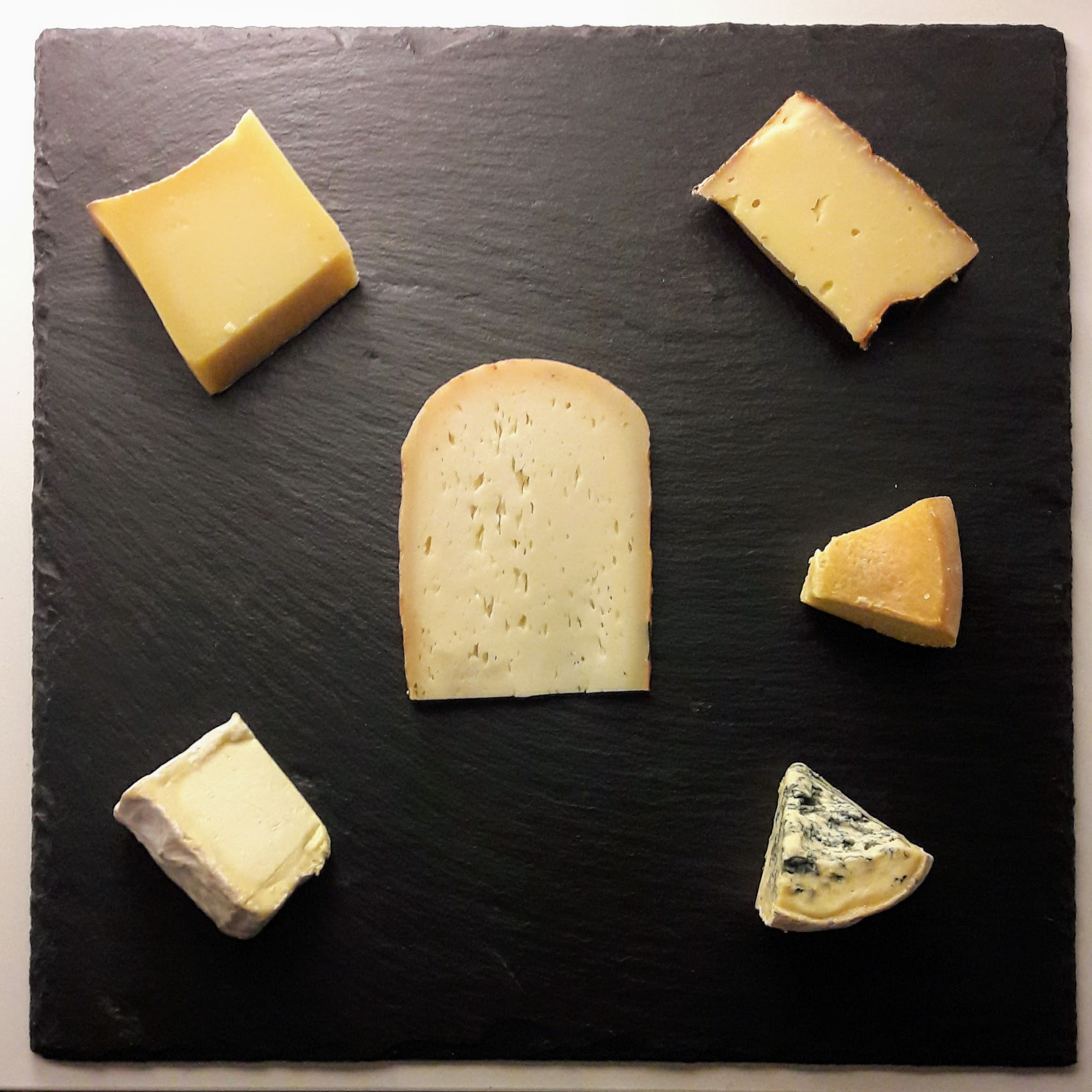 Bethmale is in the middle. From top left clockwise: Appenzeller, Mont Vully, leftover Dutch farmer cheese, Fourme d'Ambert. I don't recall what the bottom left is.