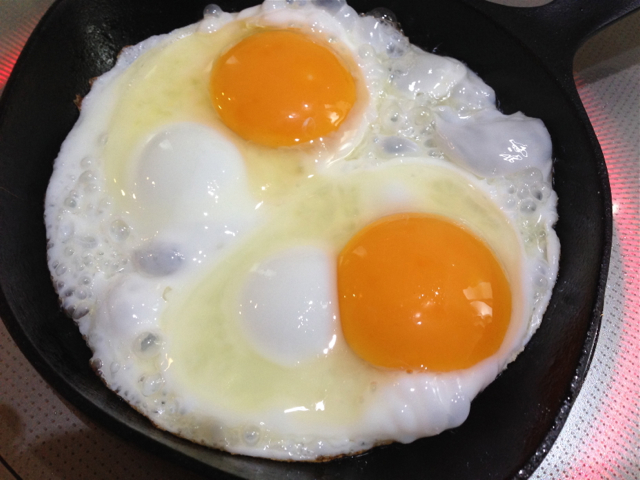 When the eggs are firm and a bit brown on the edge, flip 'em!