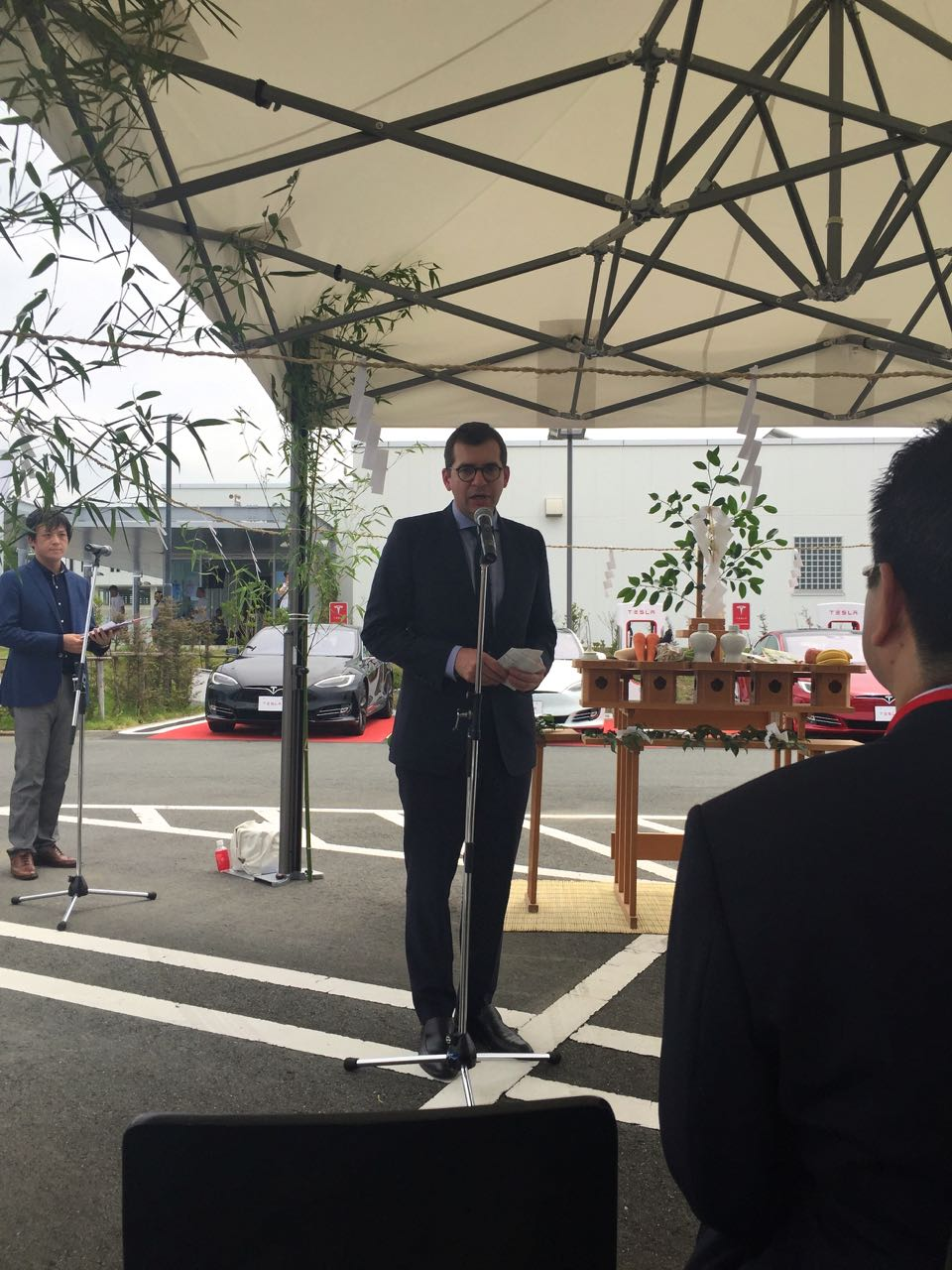 Nicolas Villeger, the head of Tesla Japan and North Asia gives opening remarks at the Hamamatsu supercharger opening ceremony.