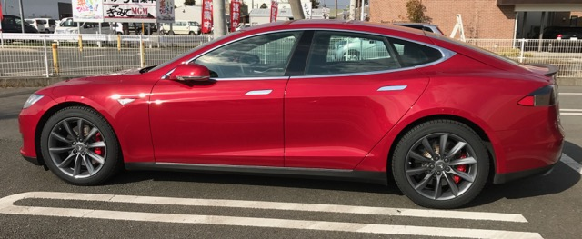 """The Red Rocket in the sun, December, 2016 with 19"""" wheels from T Sportline and Michelin X-ICE 3s"""