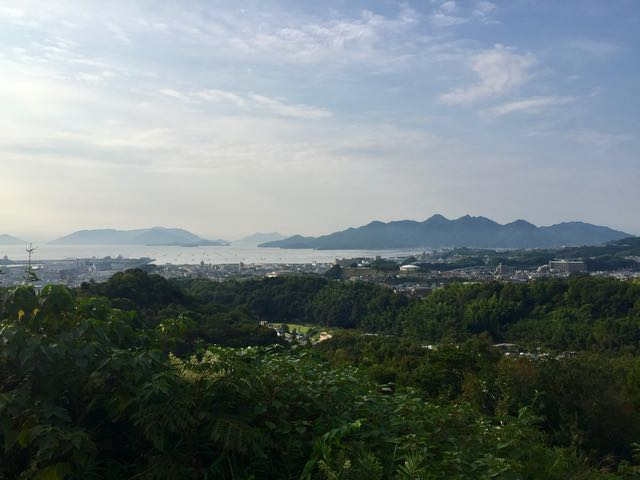 The Miyajima stop going away from Tokyo has the view! That's the area north of Hiroshima in the midground and Miyajima in the background.