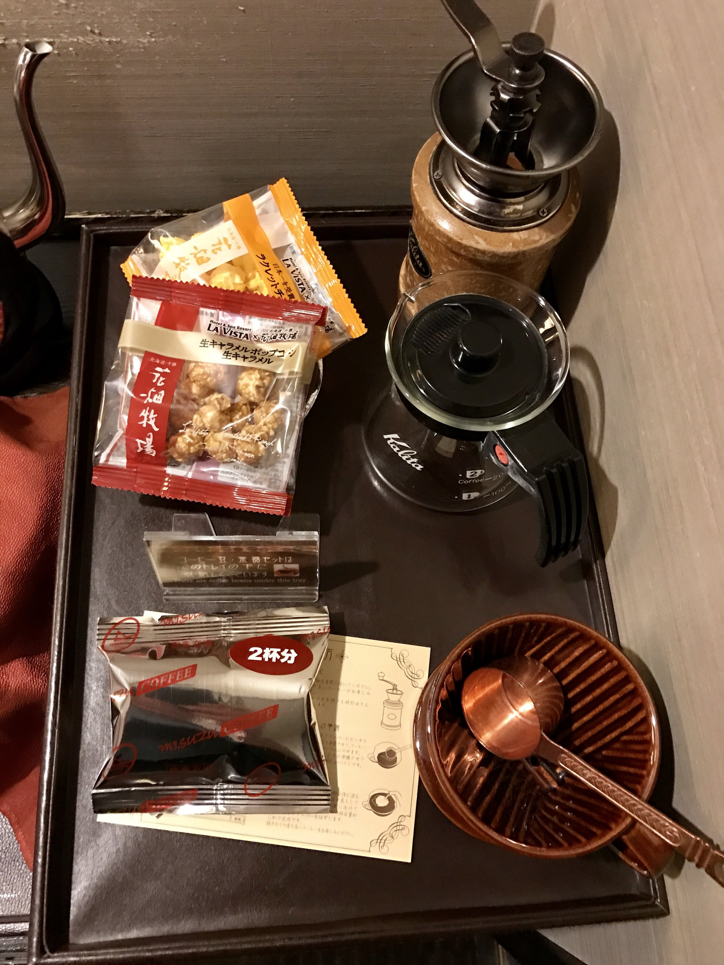Complementary coffee beans, grinder and two kinds of popcorn.