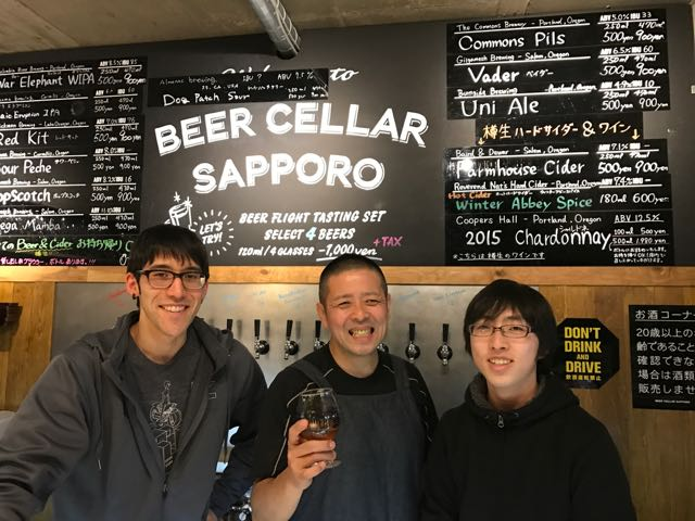 Tom, Mr. Aoki, and another staff member