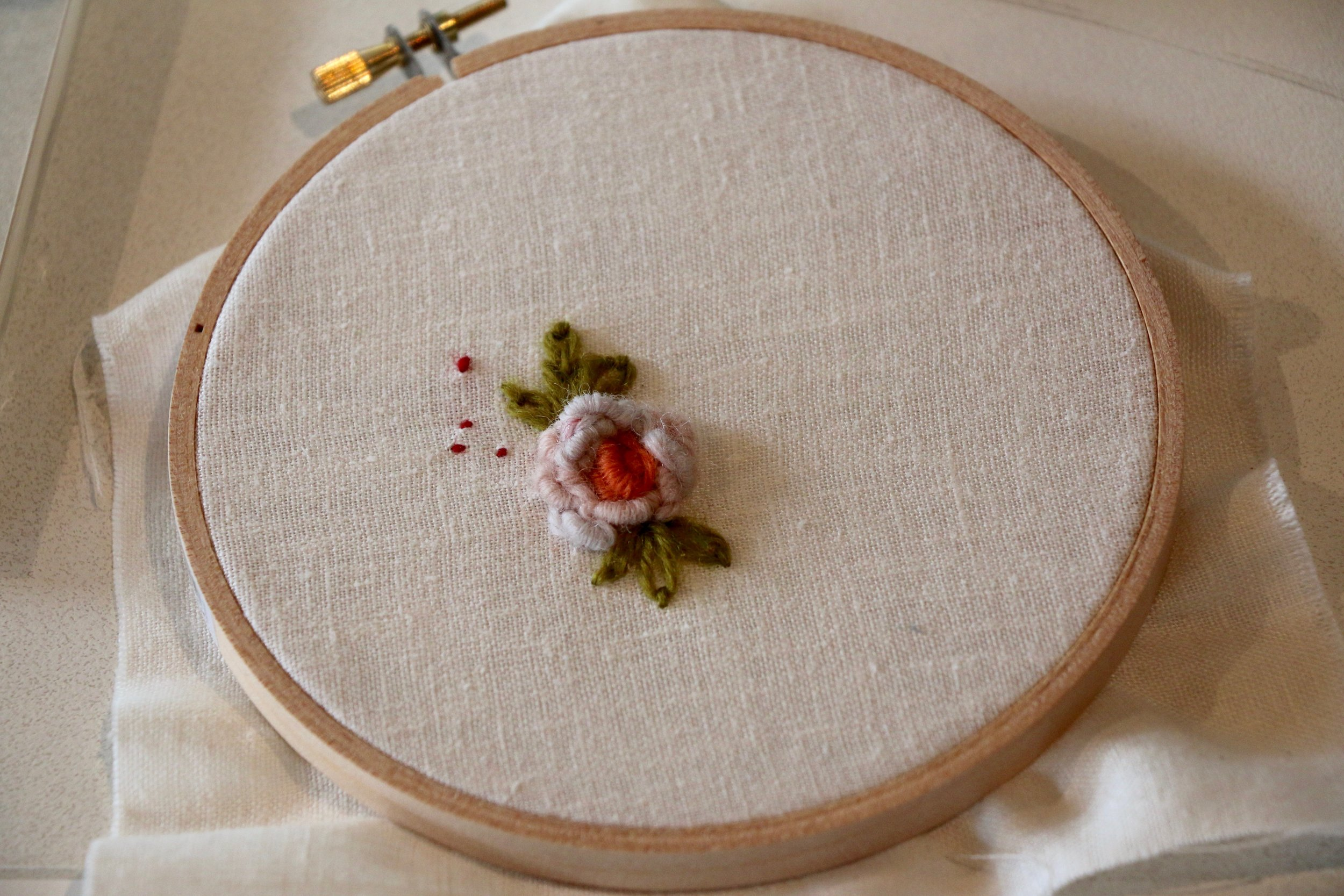 Not mine! This beautiful rosette was a sample stitched by  Elizabeth , as are the two works below.