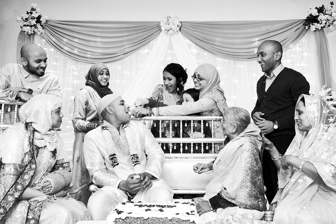 feeding of the groom at Asian Mehndi in Birmingham