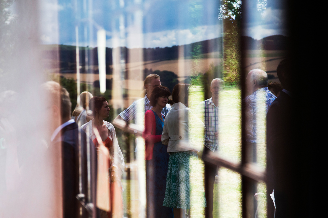 reflection of guests at wedding