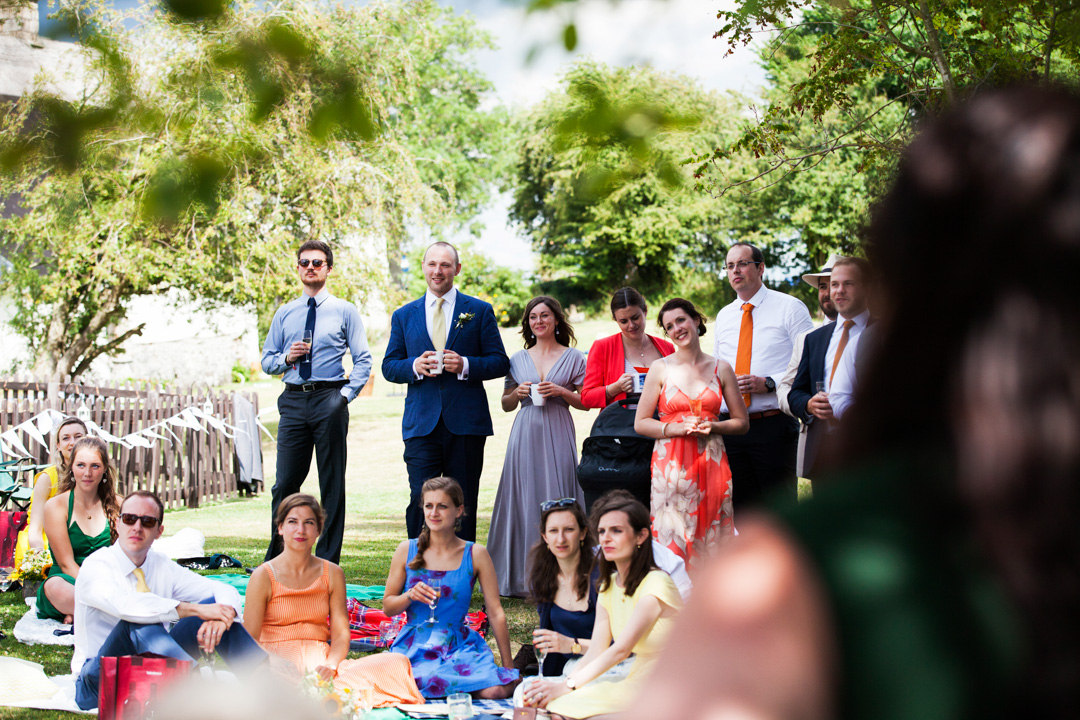 guests listen to wedding speeches