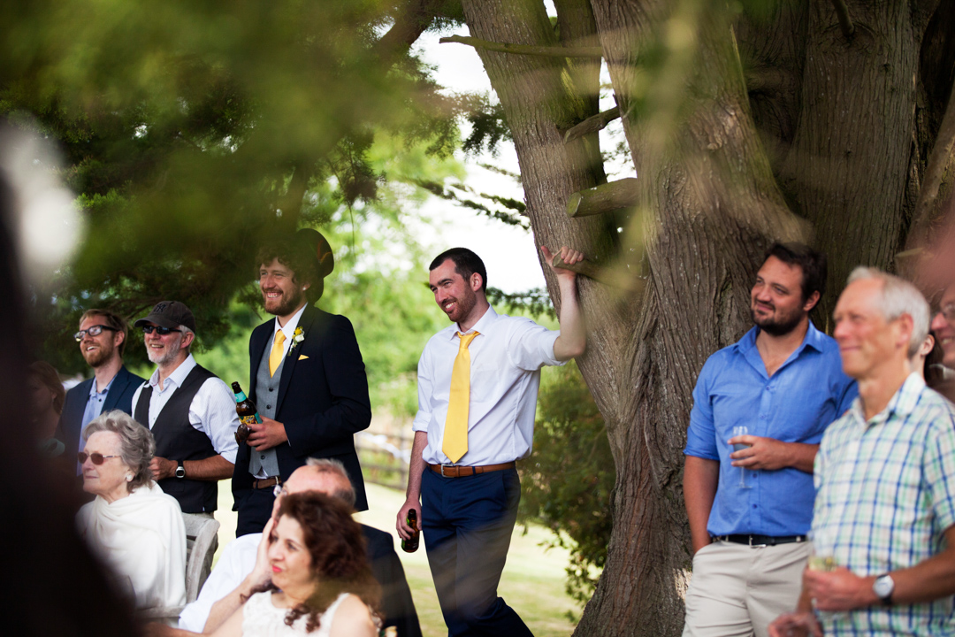 wedding guest in yellow tie