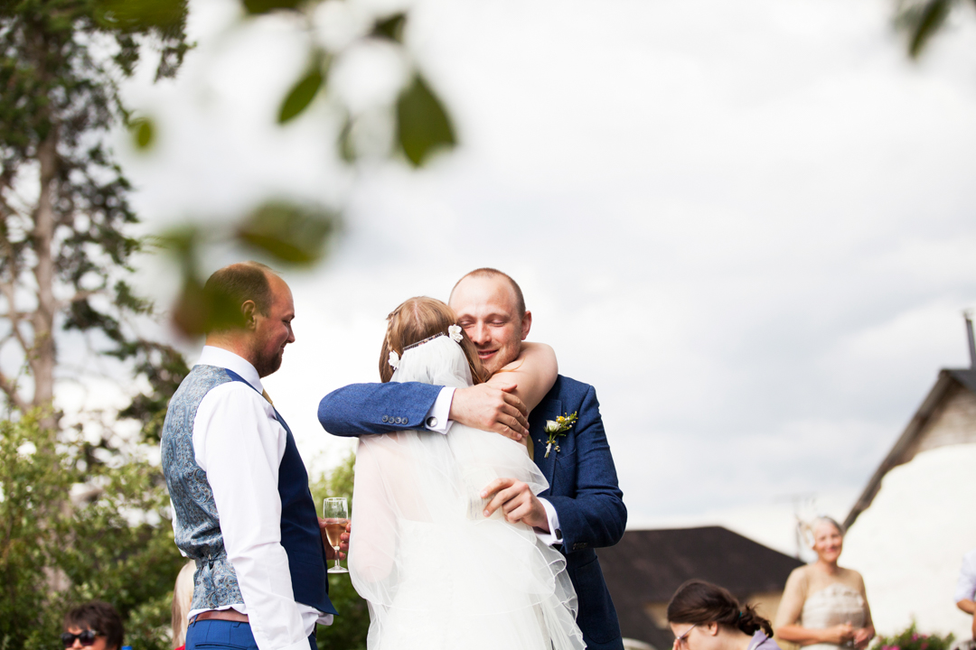 best man hugs bride