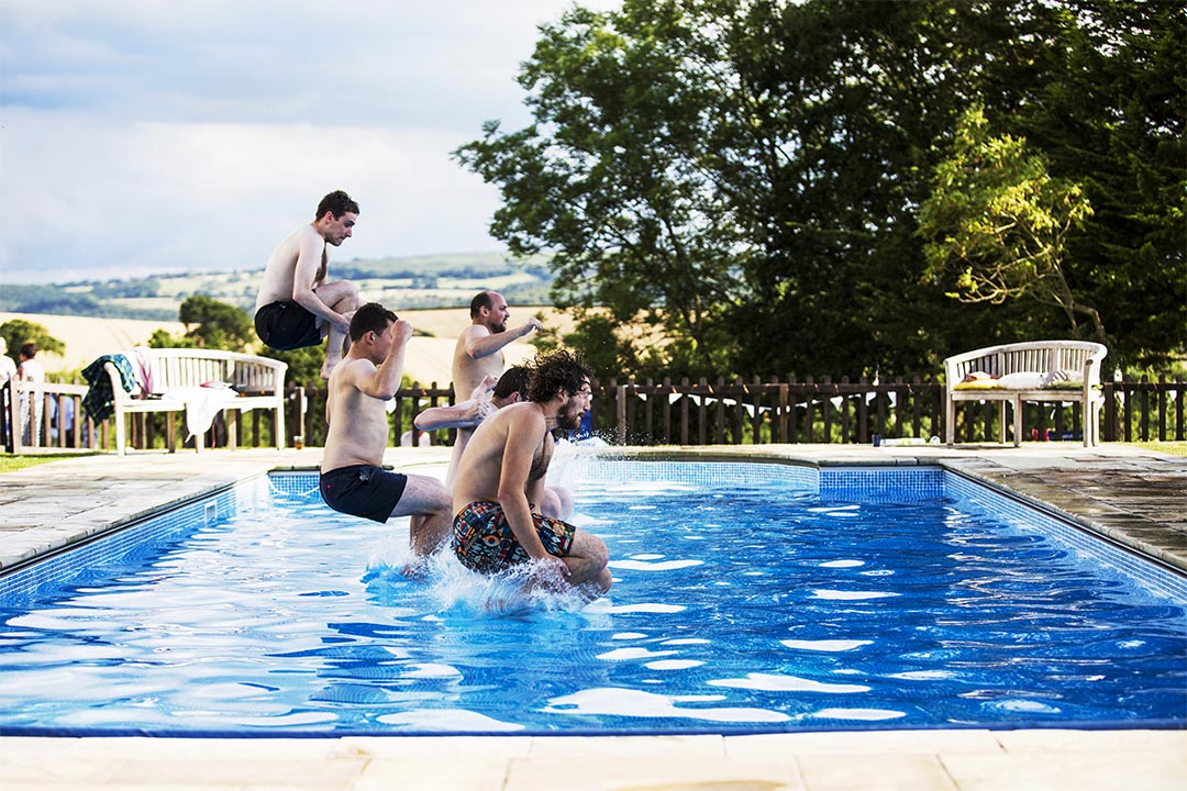 groomsmen land in swimming pool