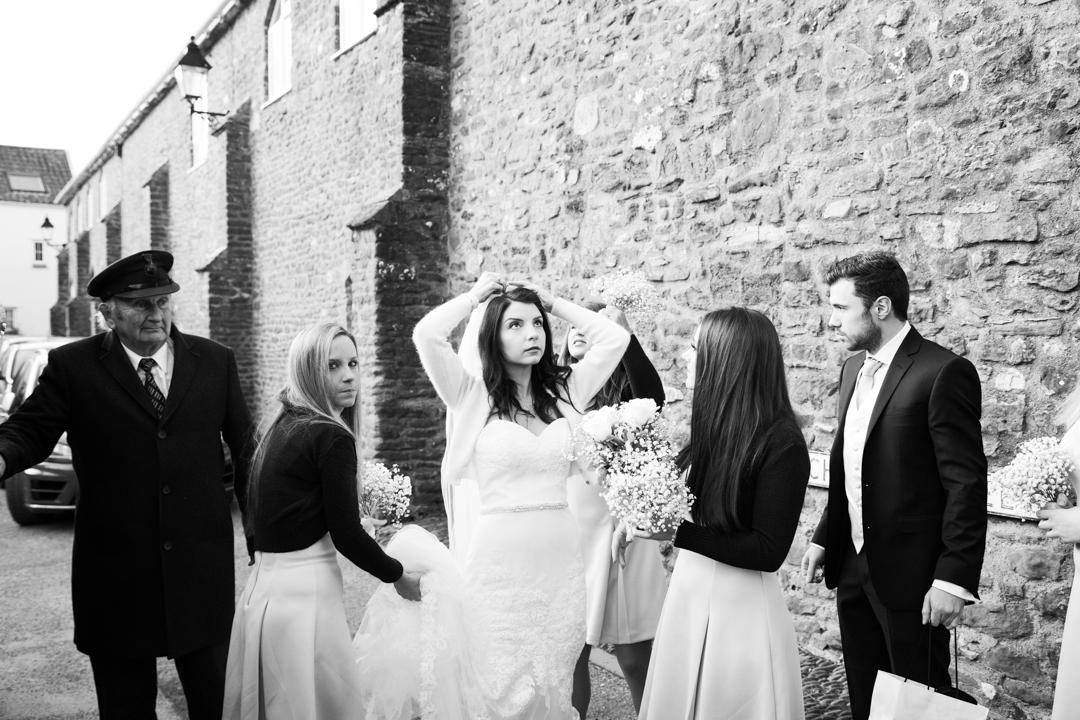 bride adjusts veil