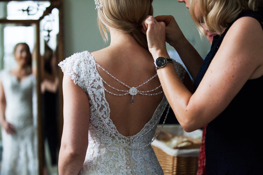 back of wedding dress with hanging jewel