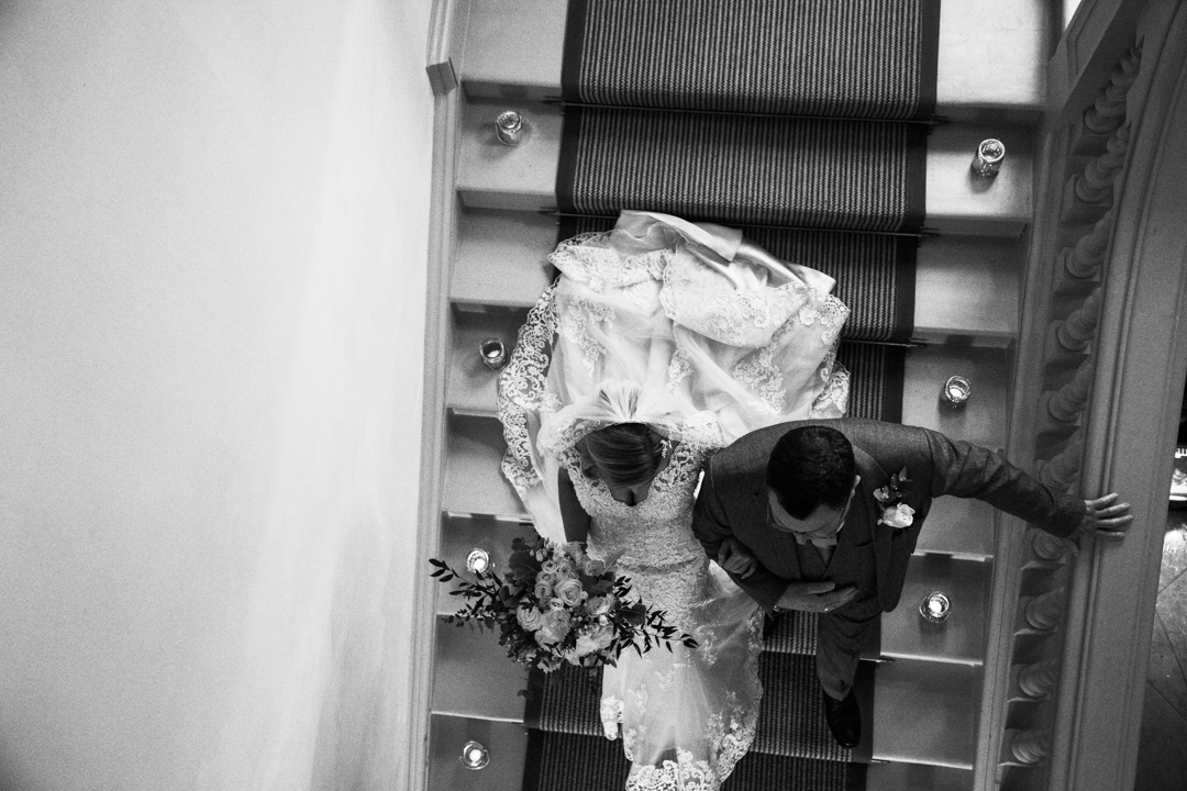 father of the bride walks bride down stairs Pynes House