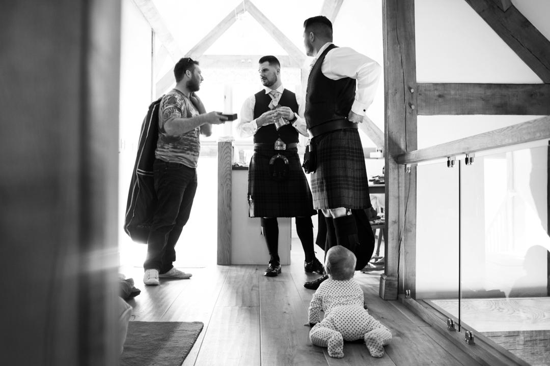 groom gets ready The Oak Barn