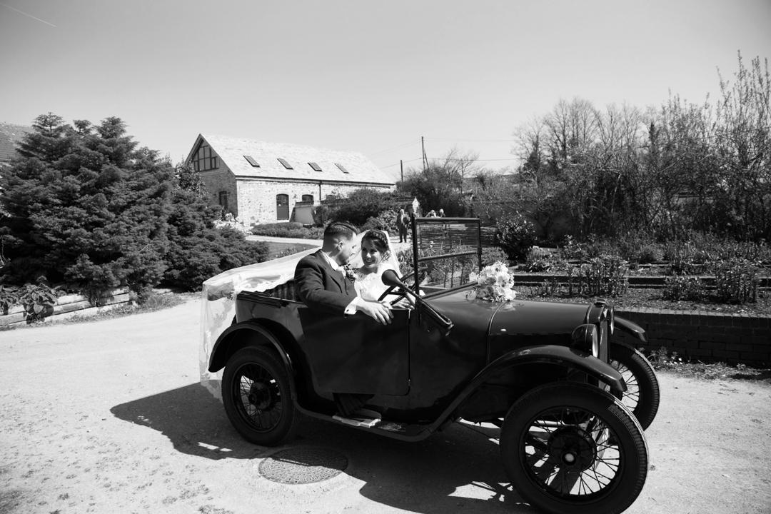 bride and groom in Austin motor