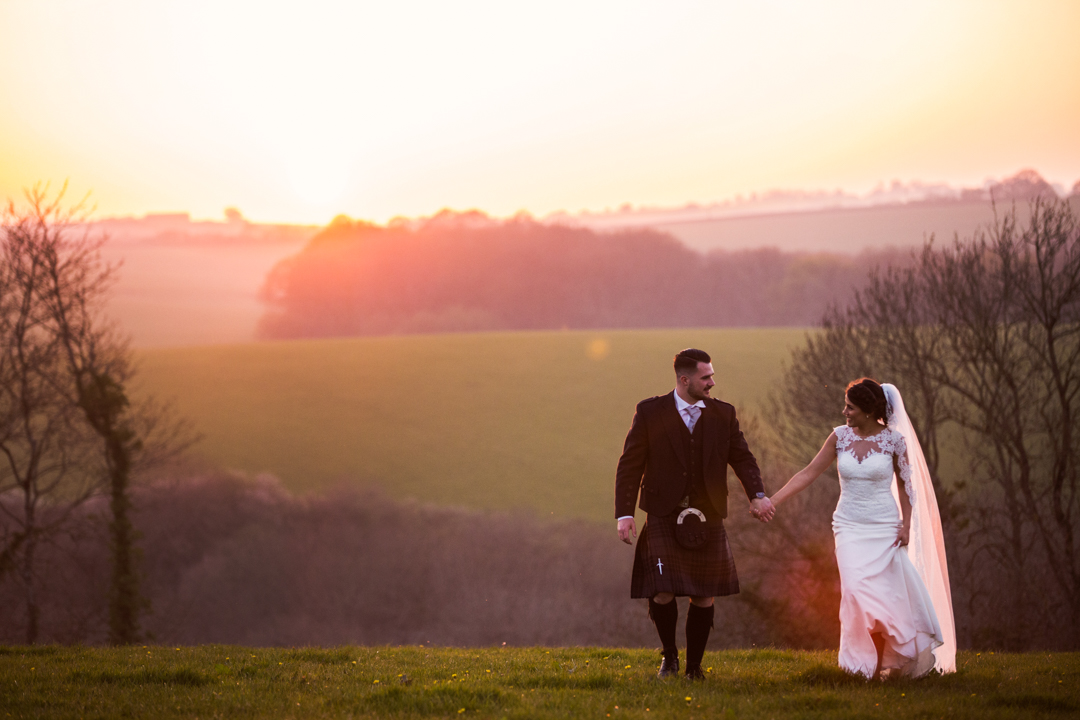 bride and groom walking by sunset Hittisleigh