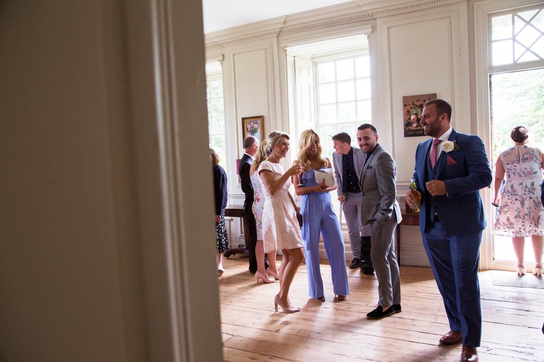 guests laughing at Kingston Estate wedding